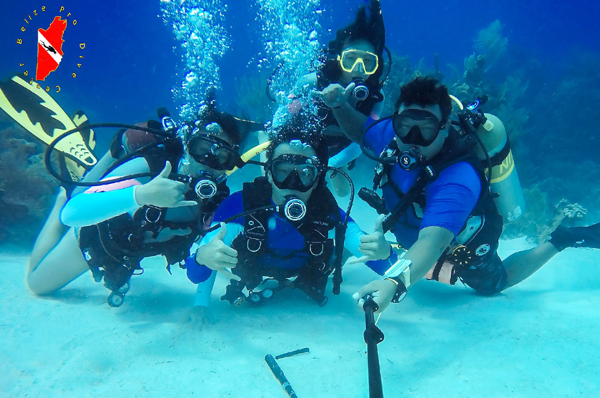 Scuba Divers Having Fun in Belize
